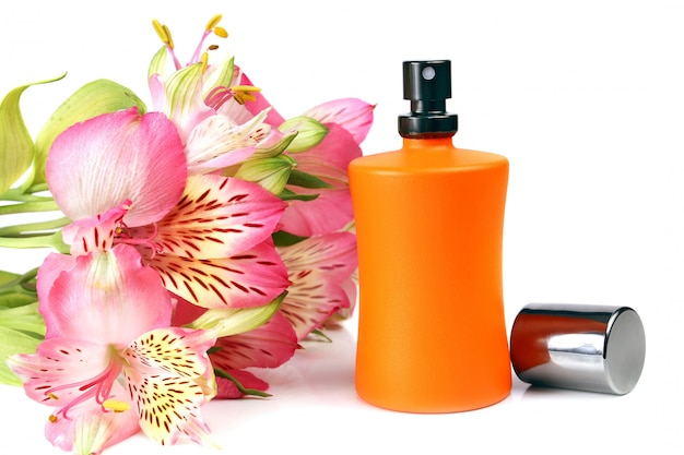 Small bottle with a perfume liquid and flowers Premium Photo