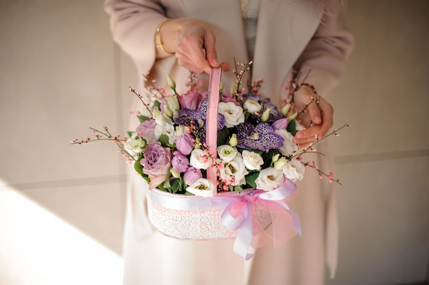 Small bouquet of various flowers in basket Premium Photo