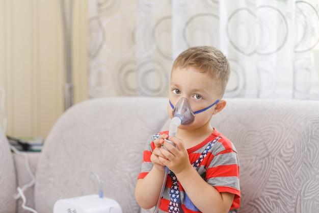 Small boy does therapeutic inhalation Premium Photo
