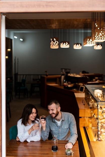 Small business partners celebrating Free Photo