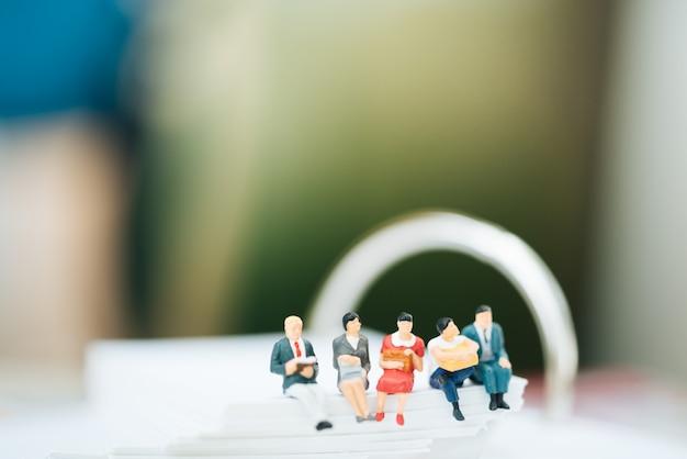 Small businessmen sitting on notebook. Premium Photo