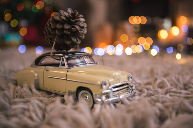 Small car with a pine cone Free Photo