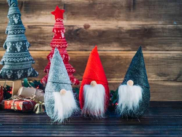 Small christmas elves on wooden table Free Photo