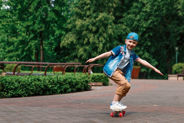 A small city boy andskateboard. a young guy is riding in a parka skateboard Premium Photo