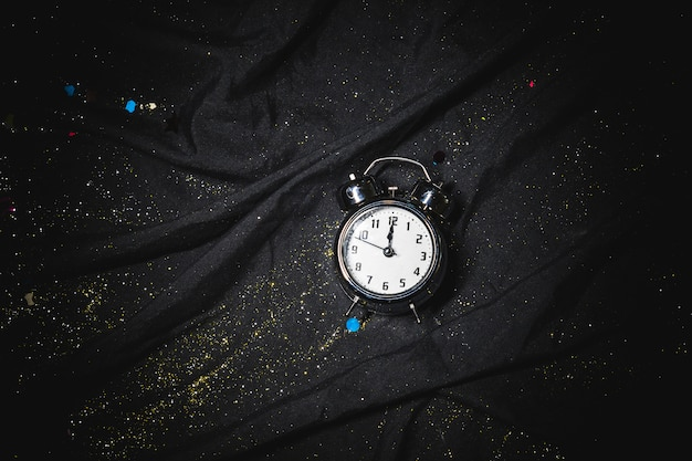 Small clock on black table Free Photo