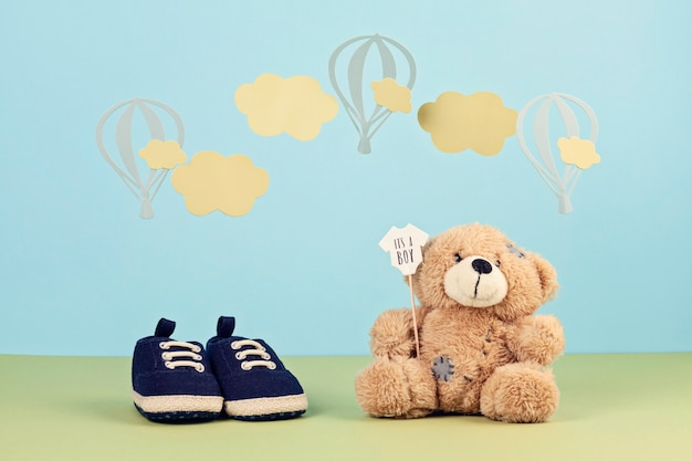 Small cute baby boy shoes over the blue background Premium Photo