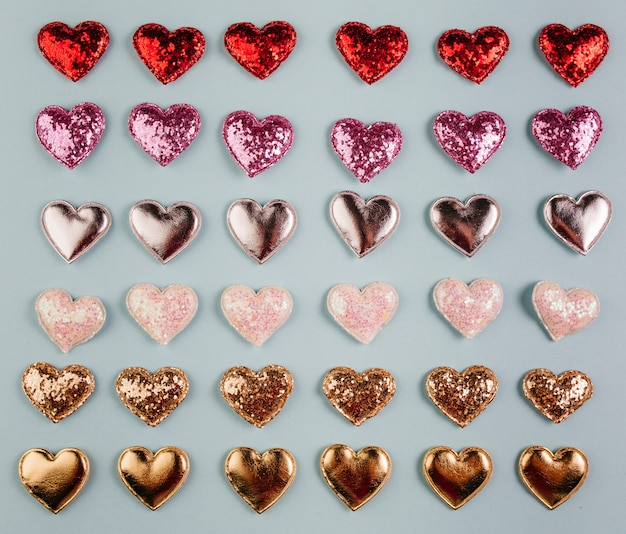 Small different bright hearts on table Free Photo