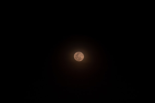 The small full moon isolated over black Premium Photo