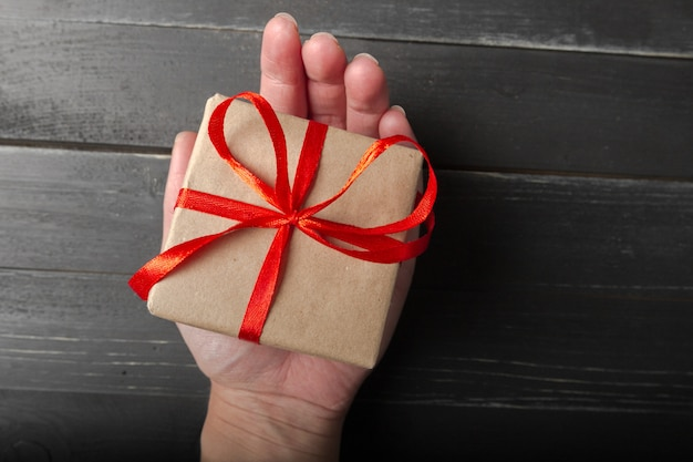 Small gift box with red ribbon close up Premium Photo