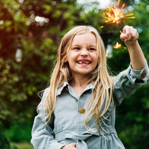 Small girl playing outdoors concept Premium Photo