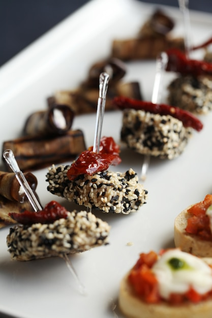 Small gourmet snacks on a plate Free Photo