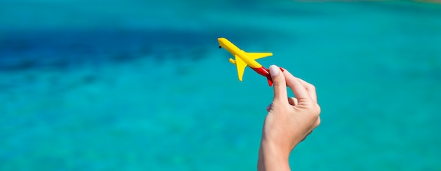 Small homemade plane on background of turquoise sea Premium Photo