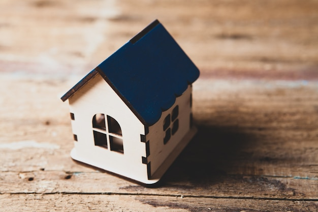 Small house on a wooden table. house concept project Premium Photo