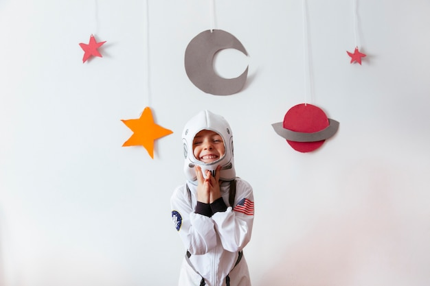 Small kid as a creative science astronaut Premium Photo