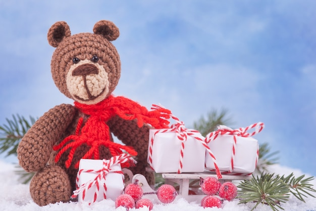 Small knitted bear, a new year's gift, a symbol of the year. christmas decor. Premium Photo