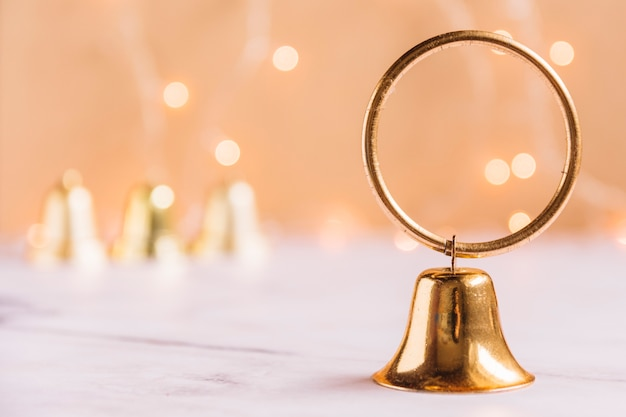 Small metallic bell on table Free Photo