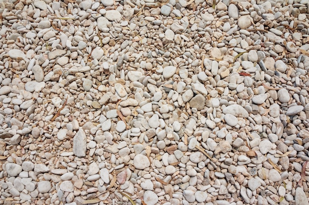 Small naturally polished rock pebbles background. Premium Photo