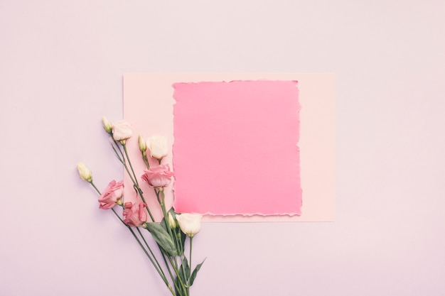 Small paper with rose flowers on table Free Photo