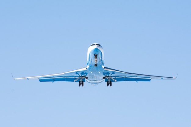 Small passenger airplane with engines at the tail. Premium Photo