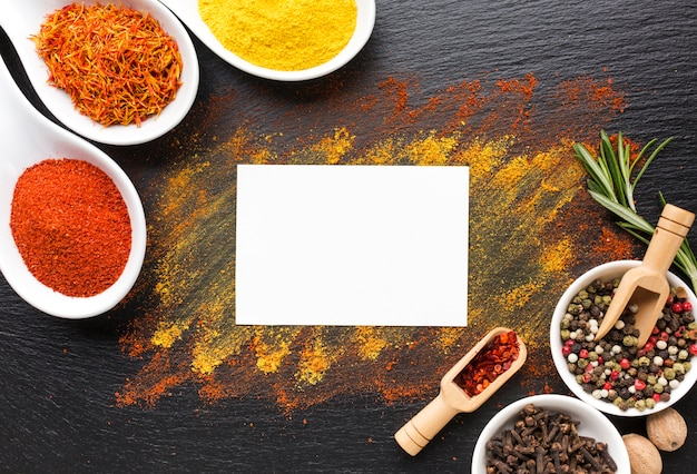 Small pieces and powder spices on table Free Photo