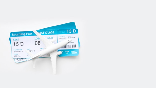 Small plane with tickets on table Free Photo