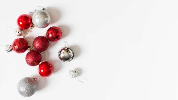 Small shiny baubles on table Free Photo