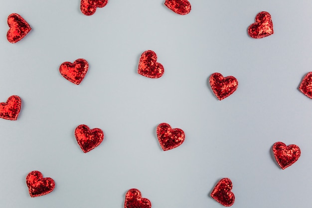 Small shiny hearts on table Free Photo