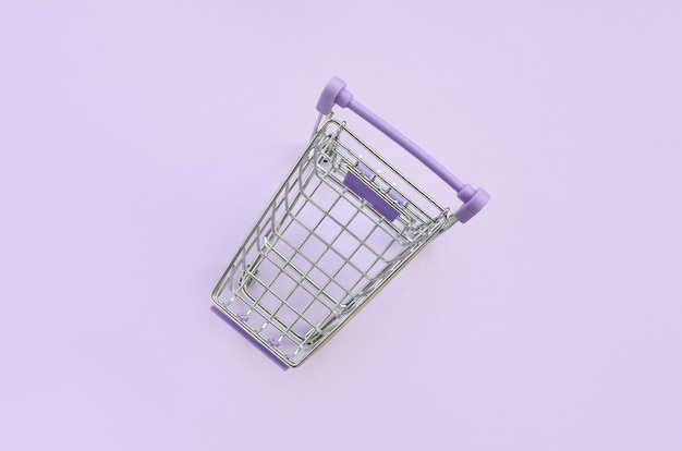 Small shopping cart. minimalism flat lay top view Premium Photo