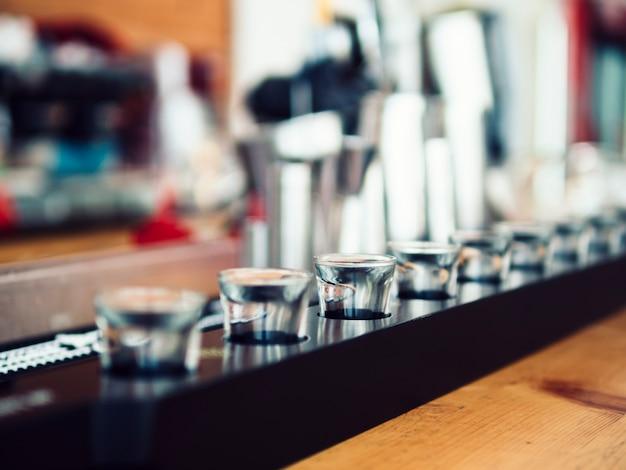 Small shot glasses on bar counter Free Photo