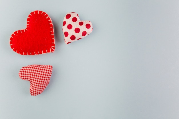 Small soft bright hearts on table Free Photo