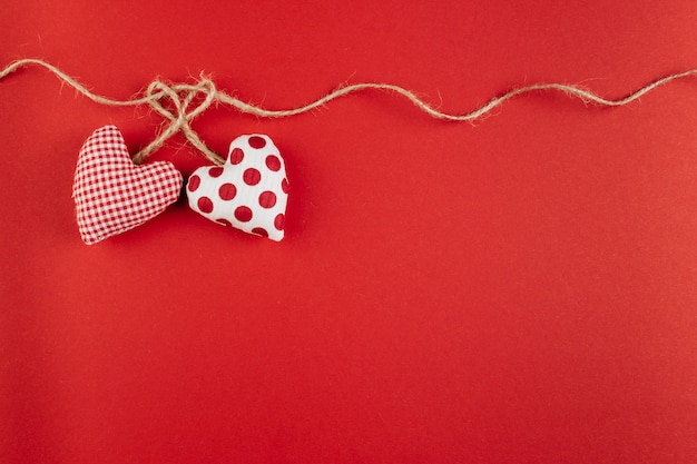 Small soft hearts with rope on table Free Photo