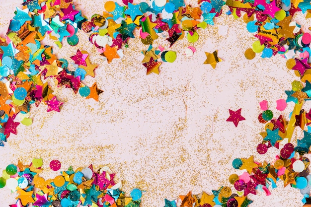 Small spangles scattered on table Free Photo
