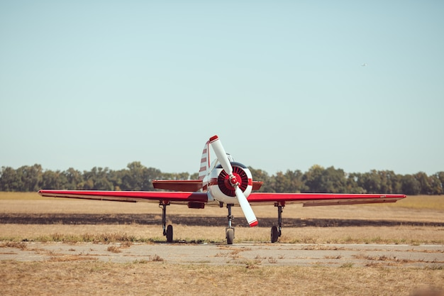 Small sport airplane at the airport. Premium Photo