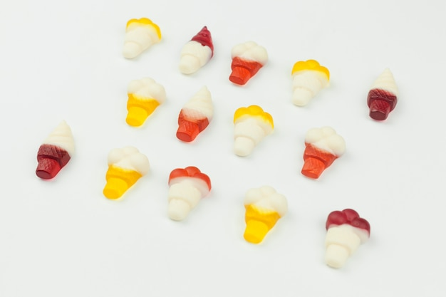 Small sweets in form of ice cream on white background Free Photo