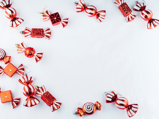Small toy candies on white table Free Photo