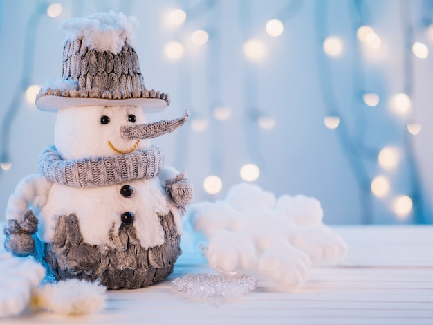 Small toy snowman on table Free Photo