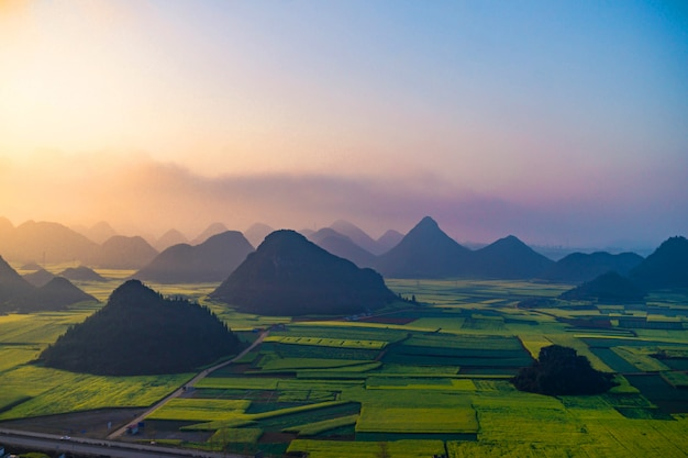 Small villages with rapeseed flowers at jinjifeng(golden chicken peak), china Premium Photo