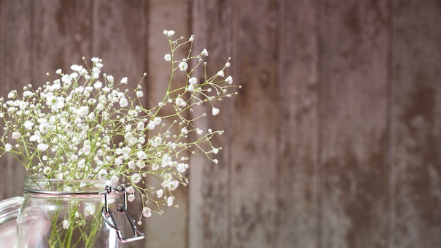Small white flowers on wooden background photo free download small white flowers on wooden background free photo mightylinksfo