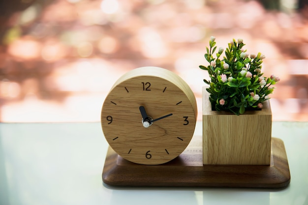 Small wooden clock with decorated flower set Free Photo