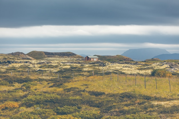 Small wooden cottage in iceland volcanic landscape Premium Photo