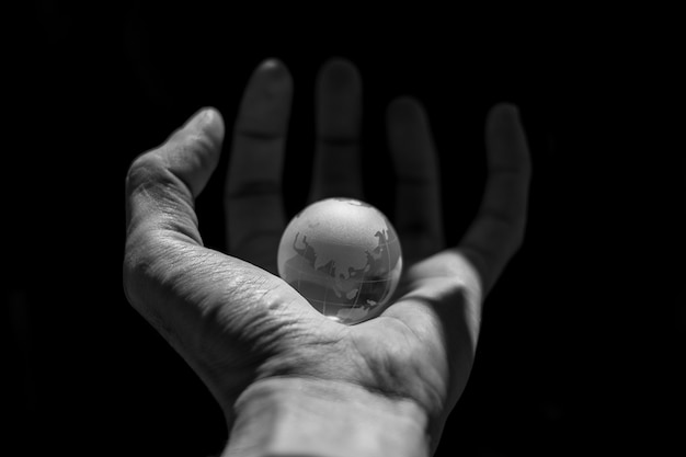 Small world in a human hand. Premium Photo