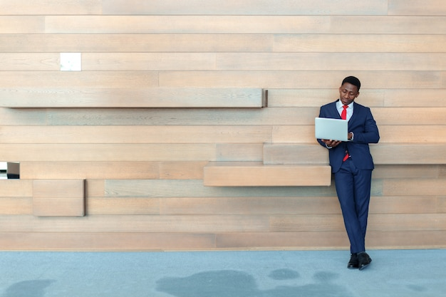 Smart african business man using laptop in office with copyspace Premium Photo
