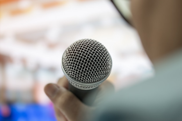 Smart businesswoman speech and speaking with microphones in seminar room or talking conference hall Premium Photo