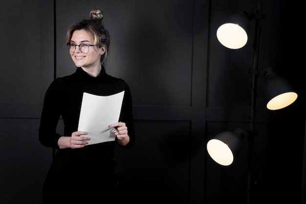 Smart businesswoman with papers looking away Free Photo