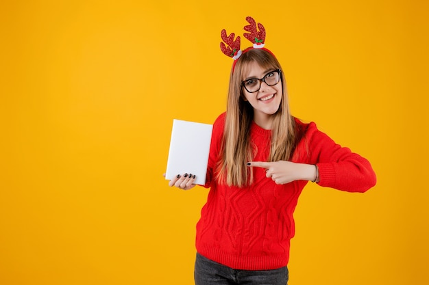 Smart funny woman holding book with copy space cover reading with glasses Premium Photo