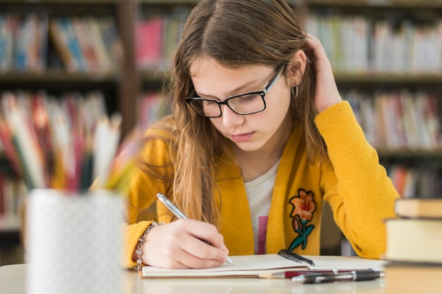 Smart girl studying in library Free Photo