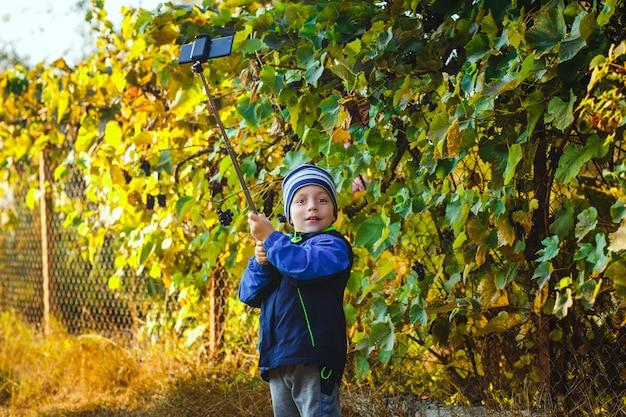 Smart happy little boy taking selfie Premium Photo
