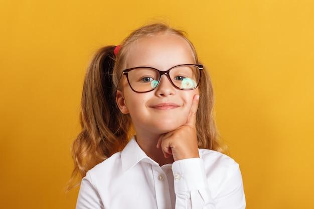Smart little girl in glasses. | Premium Photo