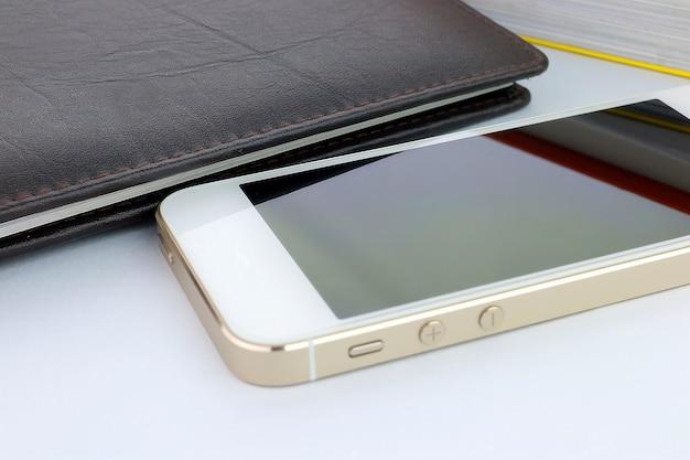 Smart phone and books Premium Photo