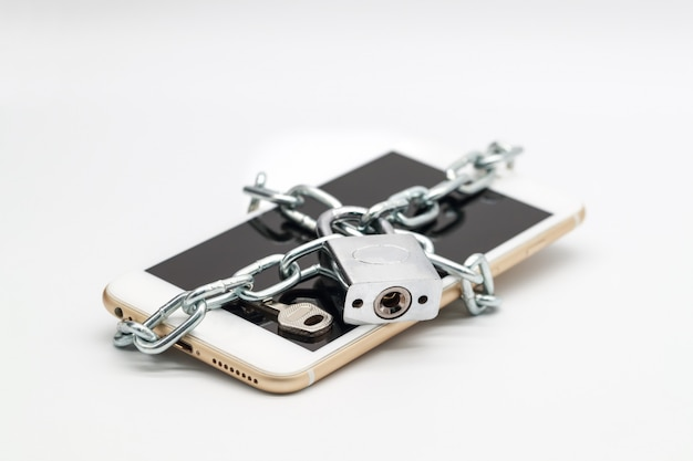 Smart phone with chain lock and money isolated Premium Photo